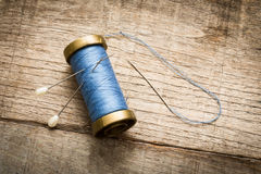 Needle and blue thread Royalty Free Stock Photo