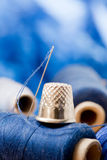 Needle with blue thread, shallow depth of field Stock Image