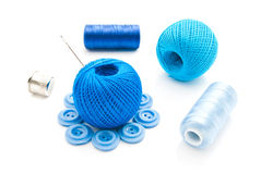 Needle, buttons, thimble and thread Royalty Free Stock Images