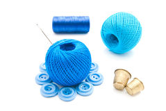 Needle, buttons, thimbles and thread Royalty Free Stock Images