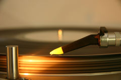 Needle and cartridge on a silver DJ turntable Royalty Free Stock Images
