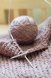 Needle or clew & detail of woven handicraft knit sweater Royalty Free Stock Photo