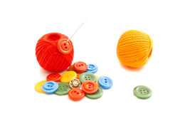 Needle, colored buttons and thread Royalty Free Stock Image