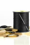 Needle, cotton and buttons Stock Images