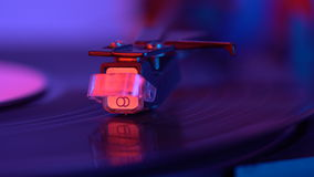 The needle drops on the disc, macro. Vinyl disc turning on retro record player. stock video footage