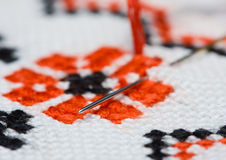 Needle in embroidery. Macro of criss-cross fragment Stock Photos