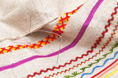 Needle on fabric with embroidery Royalty Free Stock Images