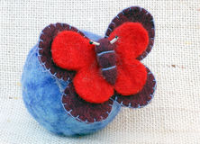 Needle felting butterfly brooch Stock Photos