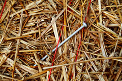 Needle in a Haystack 2. A needle stuck in a haystack bound in the twine Royalty Free Stock Images