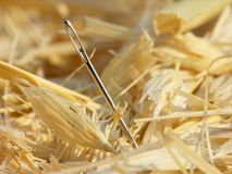 Needle in a Haystack. Close-up of a needle in a haystack.  Focus is on the eye of the needle Royalty Free Stock Photos