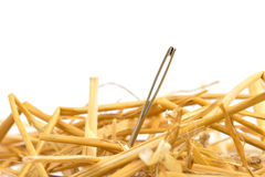 Needle in a haystack. Close up of a needle in haystack Royalty Free Stock Images