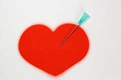 Needle and heart. Needle with a red heart on a white background Stock Photos