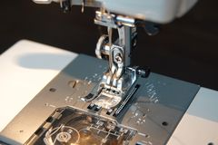 The needle mechanism of the sewing machine stock image
