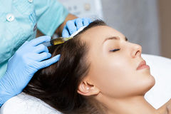 Needle mesotherapy. Cosmetic been injected in woman`s head. Thrust to strengthen hair and their growth. Needle mesotherapy. Cosmetic been injected in woman`s Royalty Free Stock Photos