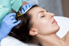 Needle mesotherapy. Cosmetic been injected in woman`s head. to s Stock Image