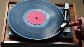 Needle moves across vinyl on turntable. Close up of turntable needle on vinyl plate stock footage