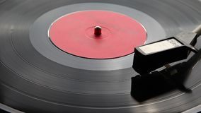 Needle moves across vinyl on turntable stock footage