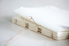 Needle And Notepad Papers On Table Royalty Free Stock Photos