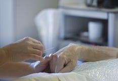 Needle older patient Stock Photos