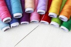 Needle in a pile of yarn Stock Images