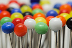 Needle pins. Macro close up multiple colors Stock Photos
