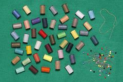 Needle , pins and sewing thread. On a green cloth Royalty Free Stock Photos