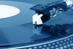 Needle on record. Needle on spinning turntable, closed-up Royalty Free Stock Photo