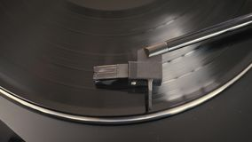 Needle on a record. Close-up of needle on a record. Turntable vinyl record player stock video