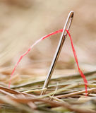 Needle with a red thread Royalty Free Stock Images