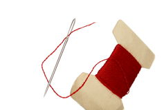 Needle with red thread Stock Image