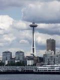 Needle's Setting. Seattle Space Needle amid cityscape buildings Stock Photo