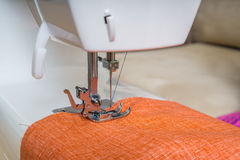 Needle of sewing machine and cloth Royalty Free Stock Image