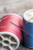 Needle  and sewing thread Stock Images