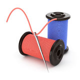 Needle and spools of thread Stock Photo