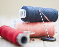 Needle and spools of threads Stock Photo
