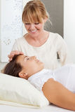 Needle Stimulation During Facial Acupuncture. Professional acupuncturist stimulating a needle in the forehead of a patient Royalty Free Stock Images
