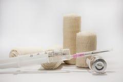 The needle with a syringe and medical bandage Royalty Free Stock Photos
