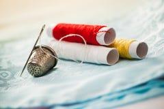 Needle thimble and cotton Royalty Free Stock Photo
