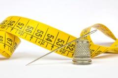 Needle and thimble Stock Image