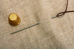 Needle thimble and thread Stock Image