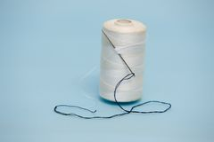 Needle and thread Stock Photography