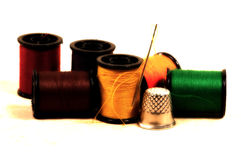 Needle and Thread. Photo of Needle and Thread With Color and Blur Effect.  Rich Saturated Color and Detail Stock Images