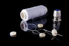 Needle, thread and buttons. Stock Photo