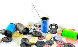 Needle, thread, buttons. Kits provide recipients with three yards of fabric, scissors, needles, threads, and buttons. Sewing kits are intended to help people Royalty Free Stock Images