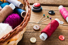 Needle and thread buttons Royalty Free Stock Photos