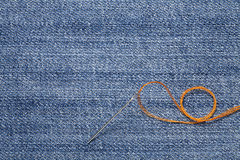 needle and thread on the denim fabric Royalty Free Stock Photography
