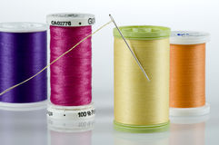 Needle and thread with four spools of thread Royalty Free Stock Photo