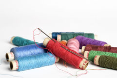 Needle and Thread reels. Needle and assorted Thread reels Royalty Free Stock Image