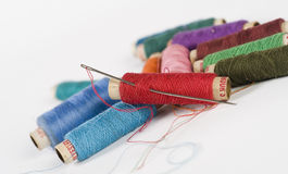 Needle and Thread reels. Needle and assorted Thread reels Royalty Free Stock Photography