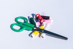Needle, thread and scissors, sewing items. Hand stitching made up of needle, thread and scissors, sewing items stock images